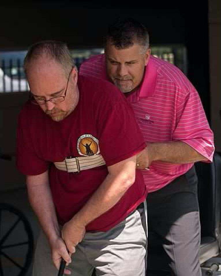 Stroke survivor with gait belt assisted by David Windsor, PGA